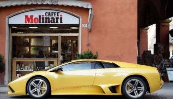 yellow Lamborghini packed outside caffe molinari restaurant