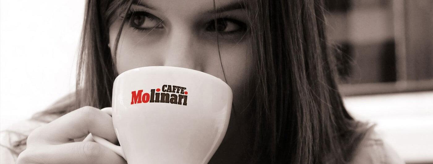 Woman drinking Caffe Molinari